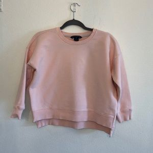 Pink/peachy Crop sweater with zipper on side.
